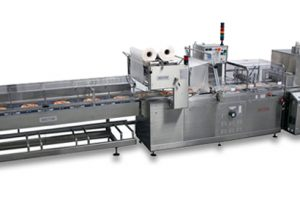Pizza wrapping machine